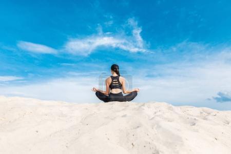 yogi meditating in lotus pose