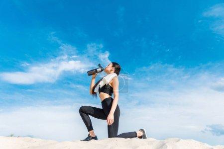 sportswoman drinking water