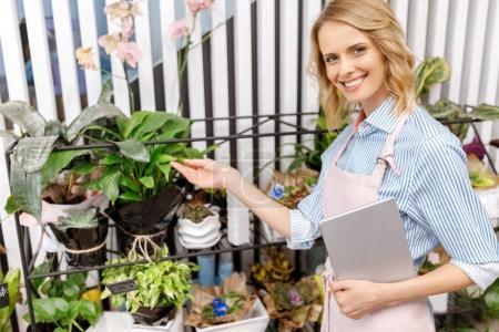 florist with digital tablet in flower shop