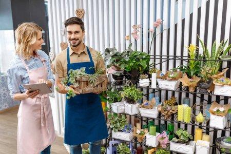 florists with digital tablet in flower shop