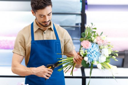 Florist cutting flowers