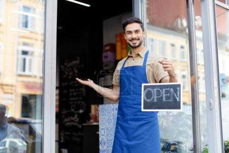small business owner with open sign