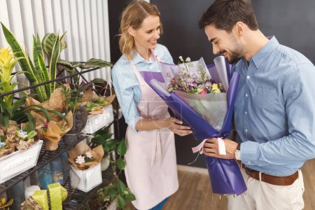 Florist and buyer with bouquet