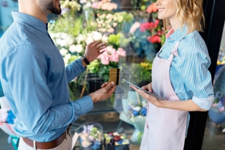 Florist and buyer with credit card