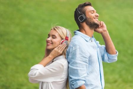 Couple listening music in headphones
