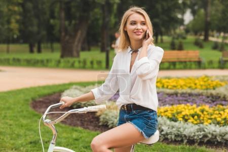 woman talking on smartphone in park