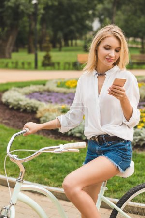 Woman with smartphone in park