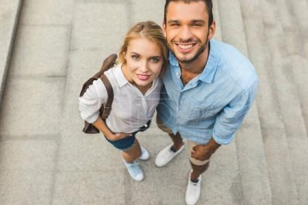 smiling couple on street