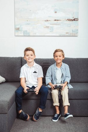 boys playing with joysticks
