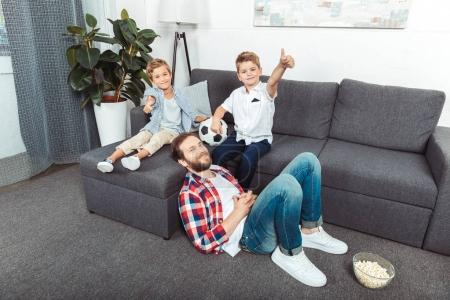 father with sons spending time at home