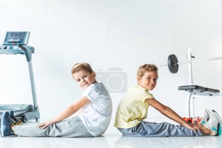 little boys exercising together