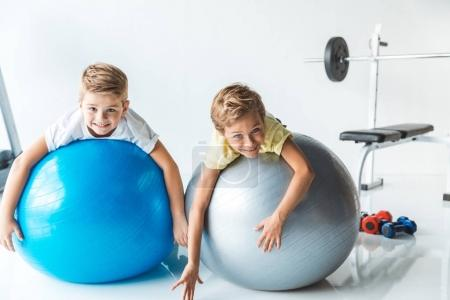 little boys on fitness balls