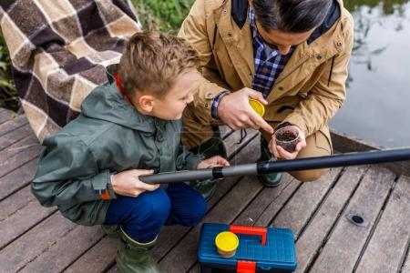 father and son with fishing rod