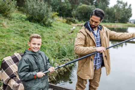 father and son fishing together