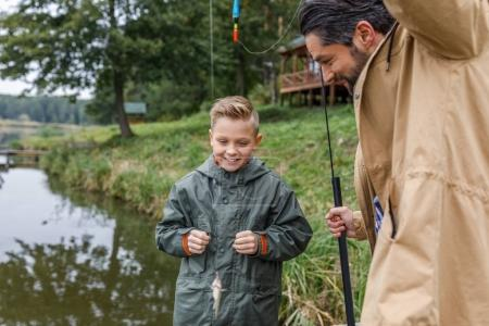 Father and son with little fish