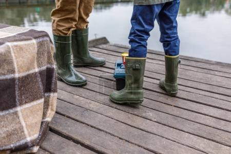 father and son in rubber boots