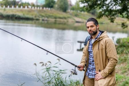 man fishing with rod