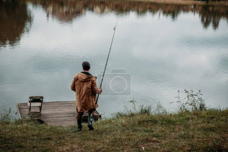 fisherman fishing with rod