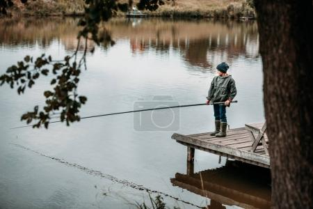 little boy fishing with rod