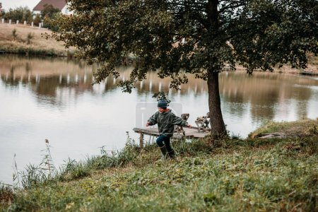 boy playing at lake