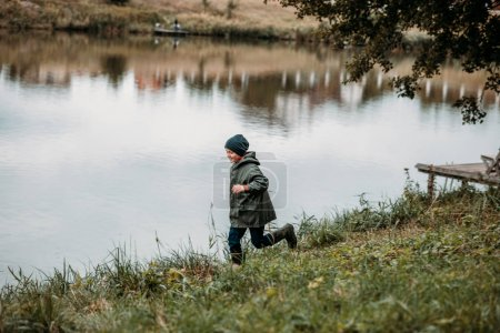 boy running at lake