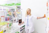 pharmacist and customer in drugstore