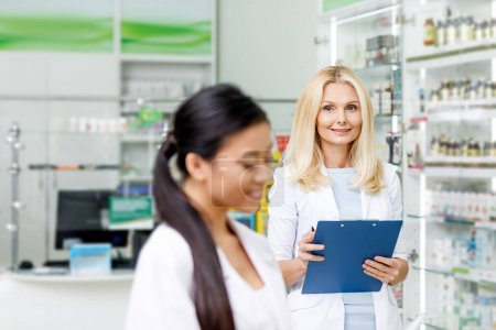 multiethnic pharmacists in drugstore