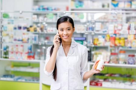 pharmacist talking on smartphone