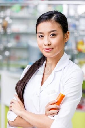pharmacist with medication in drugstore
