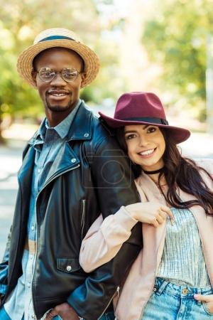 Girlfriend hugging her boyfriend on street