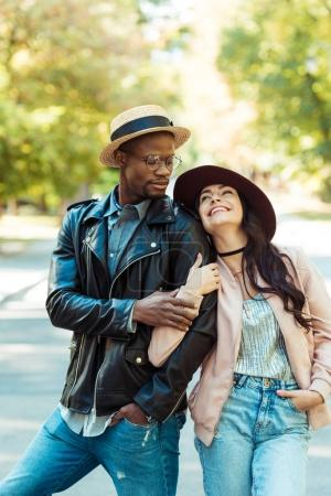 Girlfriend hugging her boyfriend on street