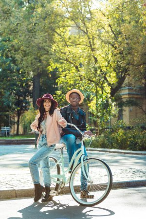 couple standing together with bicycle