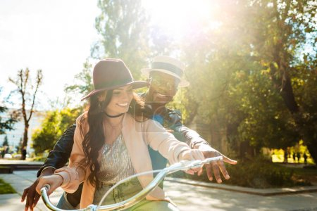 couple riding one bike together