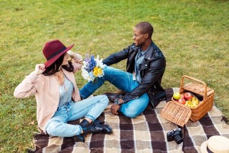 boyfriend holding flowers for girlfriend