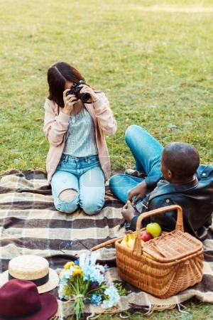 Girlfriend taking photo with film camera
