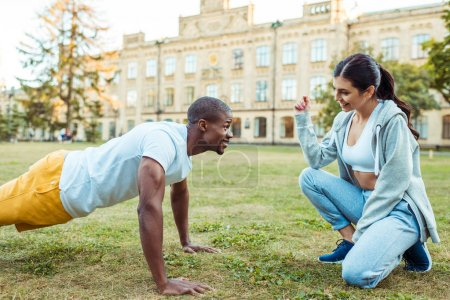 Girlfriend counting push ups of boyfriend