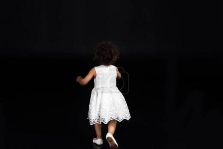 child running out in white dress