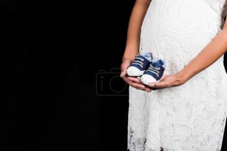 Pregnant woman with shoes