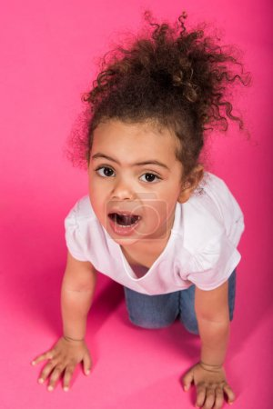 child playing and sitting on knees