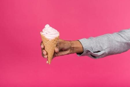woman holding ice cream in hand