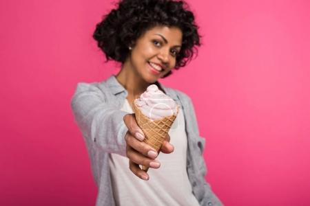 woman showing ice cream to camera