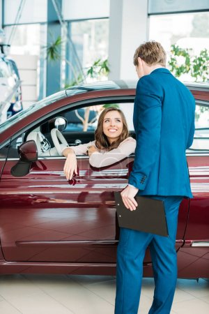 Photo for Manager talking with a customer after test-driving a car - Royalty Free Image