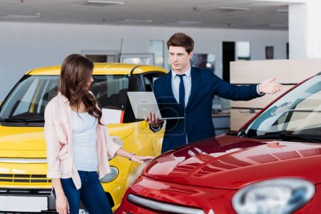 manager showing car to customer