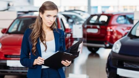 Female manager of car showroom