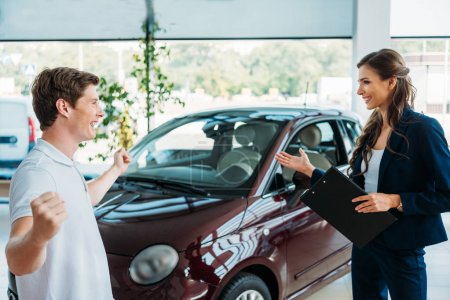 manager showing to customer car he won