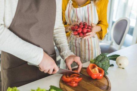Couple preparing vegetables