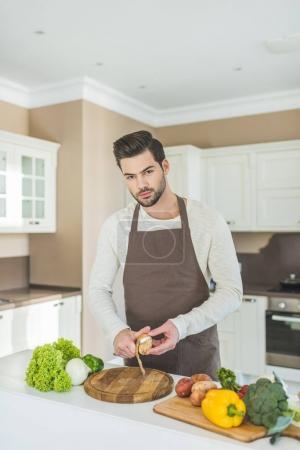 Man slicing potato