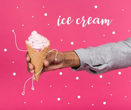 Photo for Cropped image of hand  holding ice cream with funny face  isolated on pink - Royalty Free Image