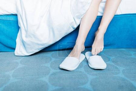 cropped image of girl wearing slippers in morning