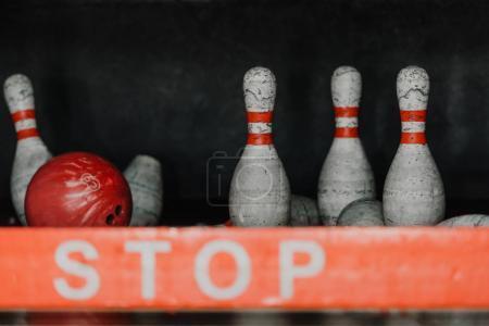 bowling ball crushing pins behind stop sign